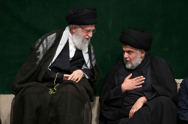 Supreme Leader Ayatollah Ali Khamenei, left, greets Iraqi Shiite cleric Muqtada al-Sadr during a mourning ceremony commemorating Ashoura, the death anniversary of Hussein, the grandson of Prophet Muhammad, in Tehran, Iran, Tuesday, Sept. 10, 2019. (Office of the Iranian Supreme Leader via AP)