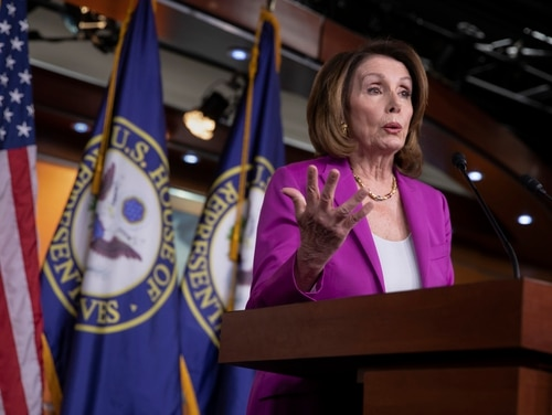 House Minority Leader Nancy Pelosi, D-Calif., speaks with reporters at the Capitol in Washington on April 12, 2018. (J. Scott Applewhite/AP)