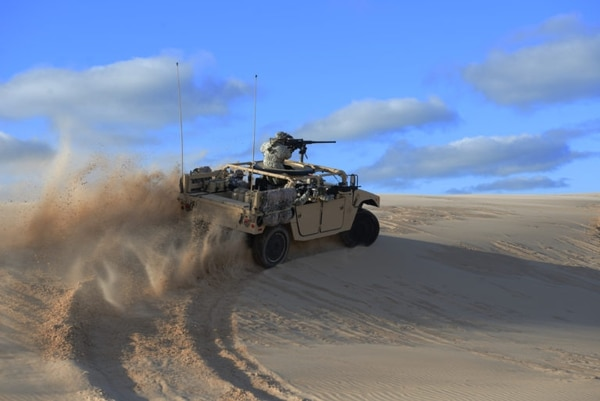 After the Army reaches its procurement objective for the Joint Light Tactical Vehicle, it will have an enduring requirement for 54,800 Humvees, possibly like the one shown here made by AM General. (Courtesy of AM General)