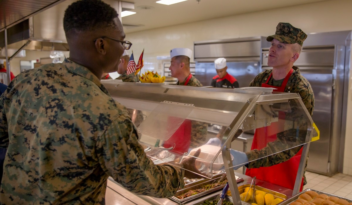 seth wolcott serves food to patrons at the camp foster chow hall aboard marine corps base smedley d butler in 2017 lance cpl andr t peterson marine