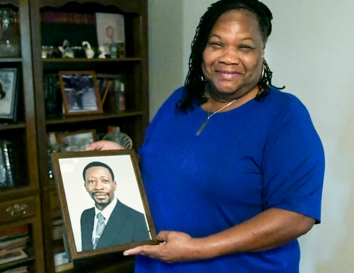 Claretha Singleton holds a photo of her husband, William Singleton a Vietnam War veteran who died in 1999 from Agent Orange disease, on Nov. 14 at her home on St. Helena Island, S.C. (Drew Martin/The Island Packet via AP)