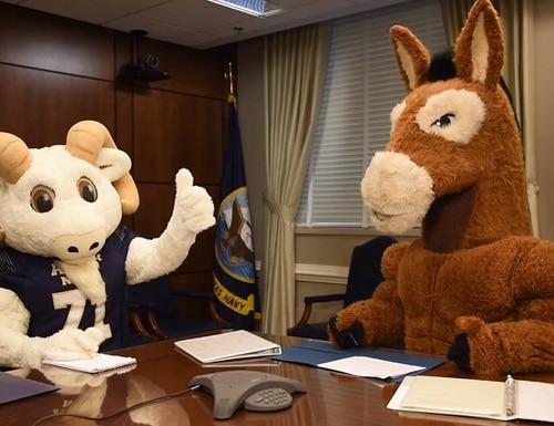 Bill the Goat and Blackjack the Mule give a pair of four-stars the silent treatment. (Screen grab via YouTube)