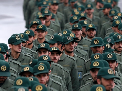 In this Feb, 11, 2019, file photo, Iranian Revolutionary Guard members arrive for a ceremony celebrating the 40th anniversary of the Islamic Revolution, at the Azadi, or Freedom, Square, in Tehran, Iran. (Vahid Salemi/AP)