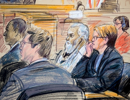 This courtroom sketch shows Ahmed Abu Khattala, third from right, listening to an interpreter through earphones during the opening statement by his defense attorney Jeffery Robinson in federal court on Oct. 2, 2017, in Washington. (Dana Verkouteren via AP)
