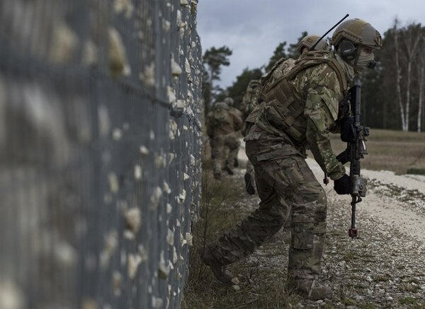 An Airman with the 2nd Air Support Operations Squadron maneuvers to the objective during training at U.S. Army Garrison Bavaria in Vilseck, Germany, Feb. 9, 2016. The training consisted of 2nd ASOS Airmen calling in close air support, neutralizing opposing forces and practicing medical evacuation by helicopter. The Airmen swapped roles as opposing forces and U.S. forces throughout the training to challenge their capabilities in controlling airpower in an urban environment. (U.S. Air Force photo/Senior Airman Jonathan Stefanko)
