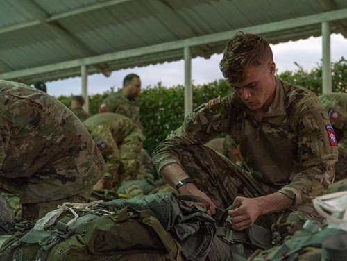 An U.S. paratrooper prepares his static-line rig at Tolemaida Air Base, in Nilo, Colombia on Jan. 26, 2020. (Spc. Edward Randolph/Army)