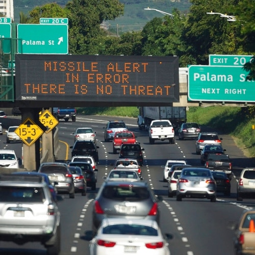 In this Jan. 13, 2018, file photo provided by Civil Beat, cars drive past a highway sign that says