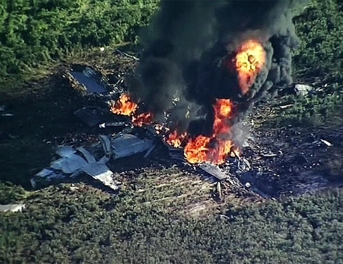 Smoke and flames rise from a Marine C-130 that crashed in a farm field in Itta Bena, Miss., July 10, 2017, killing 15 Marines and a sailor. (WLBT-TV via AP)