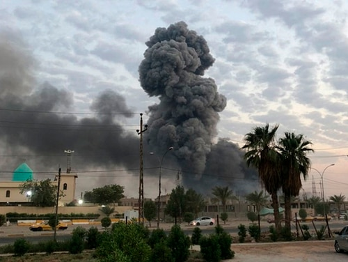 Plumes of smoke rise after an explosion at a military base southwest of Baghdad, Iraq. (AP Photo/Loay Hameed, File)