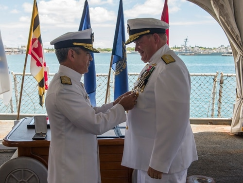 Retired Rear Adm. Mark C. Montgomery, right, was censured by the Navy this month for his role in the