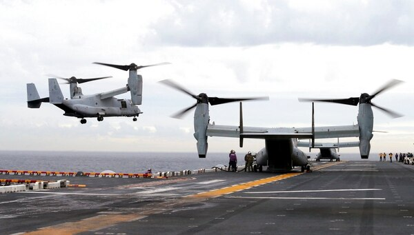 A U.S. Marine MV-22B Osprey aircraft lands on the deck of the Bonhomme Richard amphibious assault ship off the coast from Sydney during events marking the start of Talisman Saber 2017. (Jason Reed/Pool Photo via AP, File)