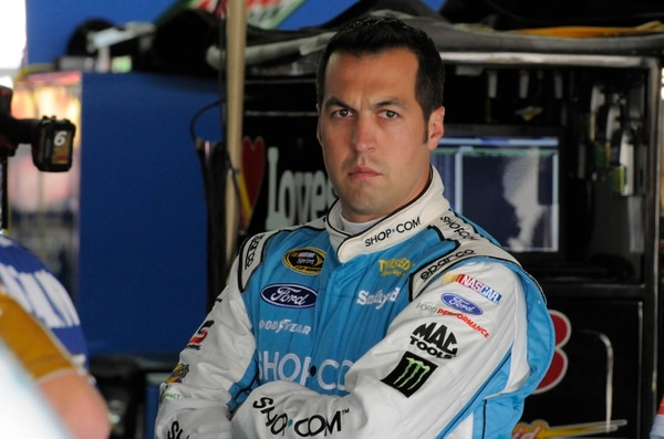 Sam Hornish Jr. waits in the garage to practice for the NASCAR Sprint Showdown auto race in Concord, N.C., Friday, May 15, 2015. (AP Photo/Mike McCarn)