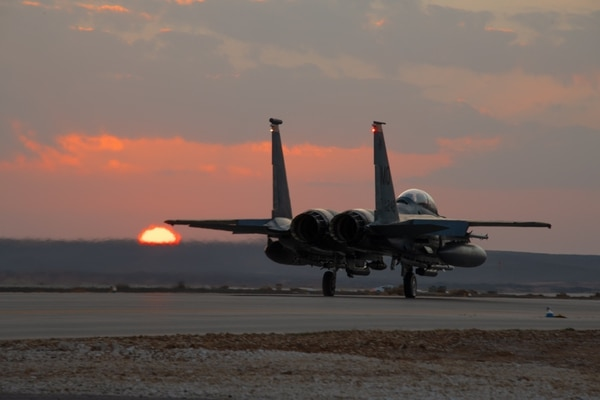 An F-15E Strike Eagle, deployed to the 332d Air Expeditionary Wing, prepares for takeoff just as the sun sets at in undisclosed location in Southwest Asia. (Master Sgt. Jonathan Young/Air National Guard)