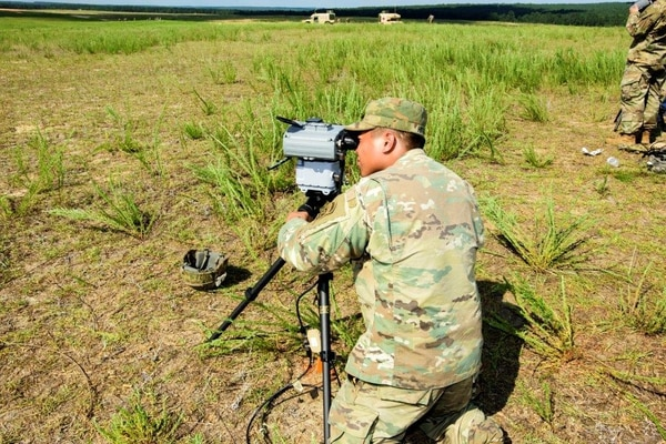 Pfc. Preshelemiah Hitgano, of 2nd Battalion, 319th Field Artillery Regiment, sets up the Joint Effects Targeting System after the system was air dropped at Fort Bragg, N.C. (Army)
