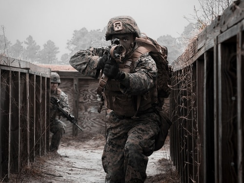 A Marine with 8th Engineer Support Battalion clears a simulated enemy cache site during a simulated live-fire event during Command Post Exercise VI (CPX) on Camp Lejeune, North Carolina, Feb. 2. (Lance Cpl. Zachary Zephir/Marine Corps)