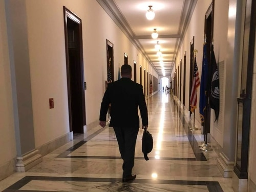 Marine Corps Veteran Brian Tally walks through a congressional office building in 2019 after meeting with lawmakers about his bill on legal reforms in the Department of Veterans Affairs. (Courtesy of Brian Tally)