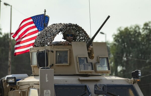 A U.S. soldier stands in an armored personnel carrier as the US forces pull out of their base in the Northern Syrian town of Tal Tamr, on October 20, 2019. (Delil Souleiman/AFP via Getty Images)