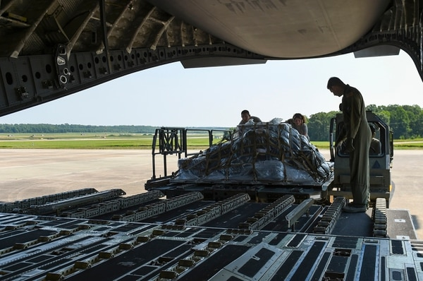 Aerial porters from the 19th Logistics Readiness Squadron load cargo onto a C-17 Globemaster on Sunday at Little Rock Air Force Base, Arkansas. More than 100 Team Little Rock members will lead, coordinate and execute maintenance operations during Mobility Guardian 2017. The exercise will test each of Air Mobility Command's core competencies including airlift, air refueling, aeromedical evacuation and mobility support operations. (Staff Sgt. Harry Brexel/Air Force)