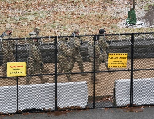 National Guard troops patrol the grounds of the Capitol in Washington, Tuesday, Jan. 26, 2021. (J. Scott Applewhite/AP)