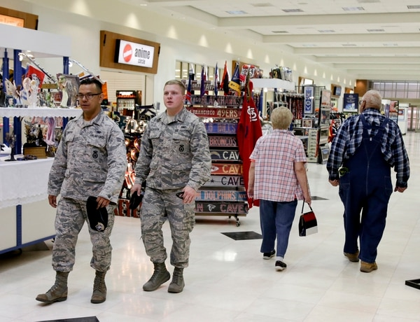 In this May 24, 2017, photo, members of the military and civilians with shopping privileges walk among stores at the Exchange at Offutt Air Force Base, Neb. (Nati Harnik/AP)