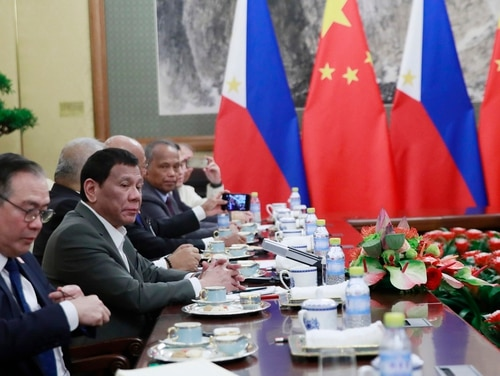 Philippine President Rodrigo Duterte, second from left, speaks to Chinese President Xi Jinping (not pictured) during their meeting at the Diaoyutai State Guesthouse in Beijing on Thursday. (How Hwee Young/Pool Photo via AP)