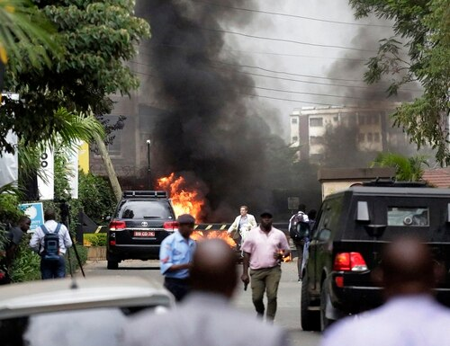 Fire and smoke rise from an explosion in Nairobi, Kenya, Jan. 15, 2019. An upscale hotel complex in Kenya's capital came under attack, with a blast and heavy gunfire. The al-Shabab extremist group based in neighboring Somalia claimed responsibility and said its members were still fighting inside. (AP Photo/Khalil Senosi)