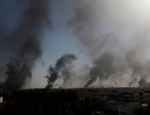 Smoke billows from targets inside Syria during bombardment by Turkish forces Thursday, Oct. 10, 2019, in this photo taken from the Turkish side of the border between Turkey and Syria, in Akcakale, Sanliurfa province, southeastern Turkey. (Lefteris Pitarakis/AP)