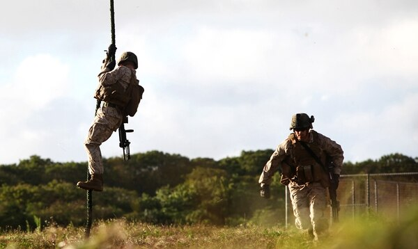Marines fast-rope out of a MH-60S