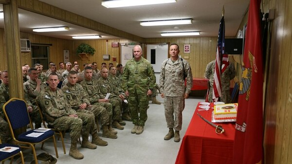 Brig. Gen. Rick Uribe, standing at right, participates in a cake cutting for the Marine Corps' 241st birthday at Forward Operating Base Union III, Baghdad, Iraq, November 10, 2016. Uribe was cited in a July 2018 Department of Defense Inspector General's report for taking gifts from subordinates and using an aide for personal errands. (Capt. Erin Bevacqua/Marine Corps)