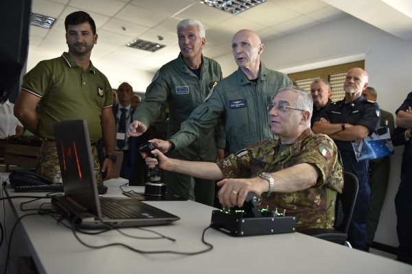 Italy teamed with the U.S. Air Force and NATO to run a virtual flight-training exercise, linking 22 simulators set up in two different countries. (Italian Ministry of Defence)