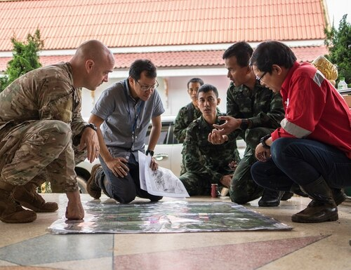 Airmen from the U.S. Indo-Pacific Command meet with Royal Thai military officials and a Thai engineering company to advise and assist in the rescue operation at Chiang Rai, Thailand. The missing Thai soccer team and their coach were successfully rescued over three days by a Thai-led multinational rescue team. (Capt. Jessica Tait/Air Force)