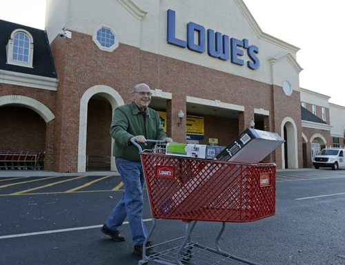 In this Nov. 18, 2014, file photo, a customer leaves a Lowe's Home Improvement store in Charlotte, N.C. (Chuck Burton/AP)