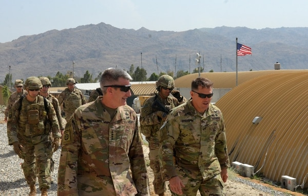 U.S. Army Gen. John Nicholson, Resolute Support and U.S. Forces-Afghanistan commander, walks with Brig. Gen. John Brennan, Train, Advise and Assist Command-East commander, during a battlefield circulation on Aug. 9, 2018, in Laghman province. (Cmdr. Robert Thoms/NATO)