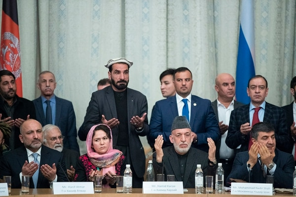 First row: Former Afghan President Hamid Karzai, third from left, Former National security adviser Mohammad Hanif Atmar and other participants of the