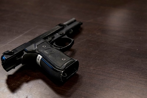 The Beretta M9 handgun is the standard issue sidearm of the Air Force. On Friday, President Donald Trump suggested relaxing restrictions on carrying personal weapons on military bases as a way to prevent future mass shootings. (Caleb Vance/Air National Guard)
