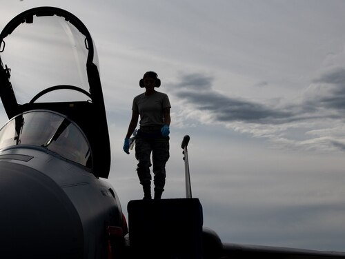 A U.S. Air Force Airman from the 44th Aircraft Maintenance Squadron conducts a post flight check on an F-15C Eagle assigned to the 44th Fighter Squadron from Kadena Air Base, Japan, during exercise Northern Edge, May 14, 2019, at Eielson Air Force Base, Alaska. The coronavirus pandemic is believed to have caused a significant spike in retention among active-duty airmen, causing the Air Force to plan voluntary programs allowing airmen to transfer early into the Guard or Reserve, or move to other career fields. (Staff Sgt. Micaiah Anthony/Air Force)
