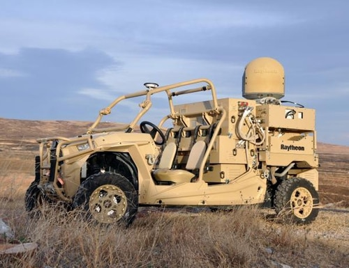 A Raytheon laser dune buggy used a solid-state laser and a sensor targeting system in a demonstration in defeating drones at an exercise at Fort Sill, Oklahoma, recently. (Army)