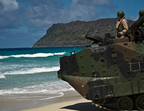 A Marine sergeant communicates through a headset to the other amphibious assault vehicle crew members prior to entering the water off Pyramid Rock beach in Hawaii in 2012. (Tech. Sgt. Michael Holzworth/Air Force)