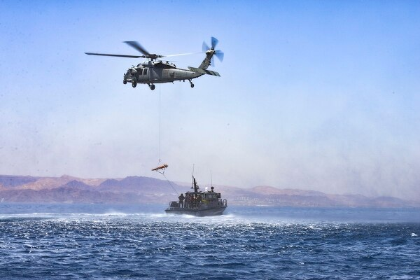An MH-60S with Helicopter Sea Combat Squadron 28 attached to amphibious assault ship Iwo Jima practices casualty evacuation procedures with a patrol boat from Royal Jordanian Navy Combat Boats Group during exercise Eager Lion on April 24, 2018. (MC1 Sandi Grimnes Moreno/U.S. Navy)