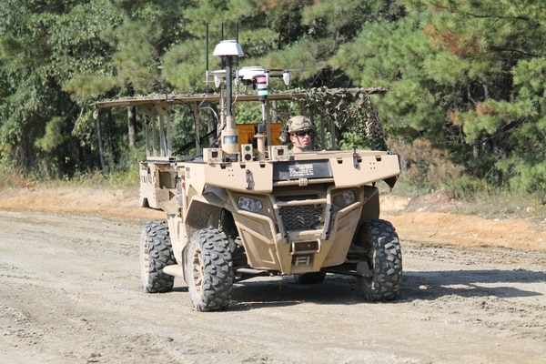 An MRZR vehicle with a tethered Hoverfly quadcopter unmanned aircraft system was used to perform reconnaissance and surveillance during two demonstrations of ground robotics at the Maneuver Center of Excellence at Fort Benning, Georgia, on July 22. The tether provided a power source the UAS to keep it loitering in the air for longer periods of time. (Photo by Jen Judson/Staff)
