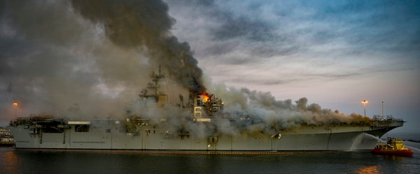 A fire continues to be fought into the evening on board the amphibious assault ship USS Bonhomme Richard (LHD 6) at Naval Base San Diego, July 12, 2020. (MC2 Austin Haist/Navy)