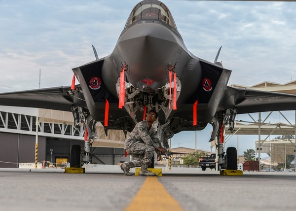 Airman 1st Class Eric Ruiz-Garcia performs an inspection on an F-35A Lightning II at Luke Air Force Base, Ariz., Dec. 1, 2017. The Air Force, Navy and Marine Corps are planning on buying 2,456 total F-35s. (Airman 1st Class Caleb Worpel/Air Force)