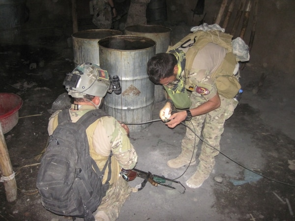Afghan forces prepare to destroy lab materials and narcotics after seizing about $19 million worth of drugs, equipment, vehicles, weapons and communication gear in Nad Ali district, Helmand province, Afghanistan, in July 2017. (DoD)