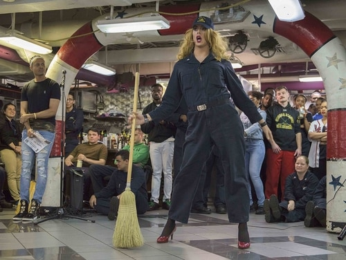Joshua Kelley, a 24-year-old yeoman 3rd class, performs as 'Harpy Daniels' for sailors aboard the carrier Reagan. (MC3 Charles J. Scudella III/Navy)