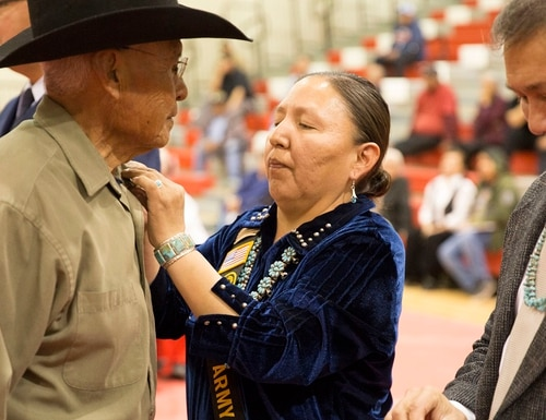 Members of the Navajo Nation, a commemorative partner with the Vietnam War Commemoration, present Vietnam Veteran lapel pins to veterans during a March 8 event in Arizona. (Charlita Walker-Moses, Vietnam War Commemoration)