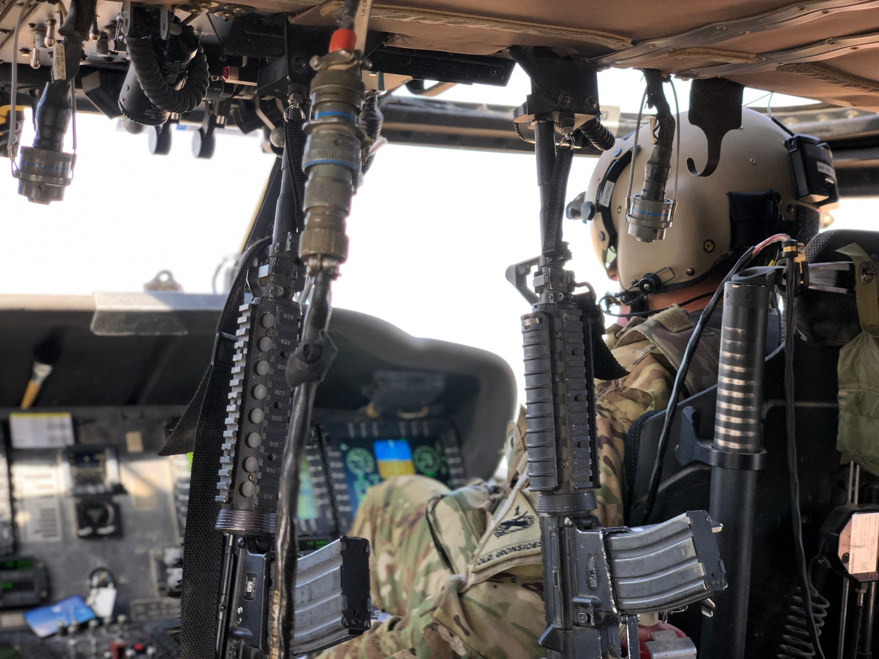A pilot with Task Force Iron Eagles navigates a UH-60 Black Hawk in Afghanistan to transport troops and supplies for a mission in support of Operation Freedom's Sentinel. (Capt. Roxana Thompson/Army)