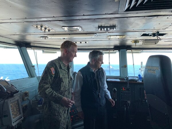 Adm. James Foggo, left, chats with U.S. Ambassador to Russia Jon Huntsman aboard the aircraft carrier Abraham Lincoln on April 23, 2019. (Matthew Bodner/Staff)