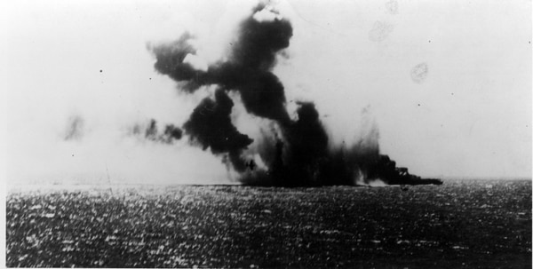 The Japanese light carrier Shoho under attack by U.S. Navy aircraft in the late morning of May 7, 1942. A TBD-1 torpedo plane is visible against the smoke in the center of the view. (National Archives)
