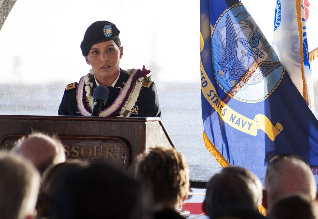 In this Nov. 11, 2015, photo, Maj. Tulsi Gabbard, Hawaii Army National Guardsman and U.S. House of Representative for Hawaii's 2nd District, delivers a keynote address during a Veterans Day ceremony aboard the Battleship Missouri Memorial at Pearl Harbor, Hawaii.