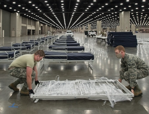More than 30 members of the Kentucky Air National Guard's 123rd Civil Engineer Squadron set up hospital beds and clinical space at the Kentucky Fair and Exposition Center in Louisville, Ky., April 13, 2020. (Dale Greer/Air National Guard)
